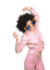 Young woman wearing afro wig and big glasses