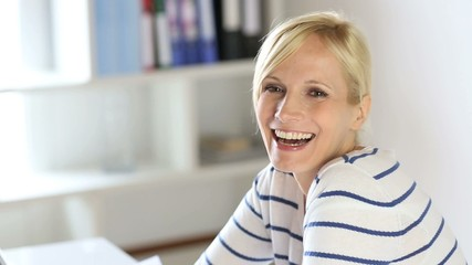 Cheerful office worker looking at camera