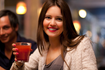 Woman holding a cocktail glass