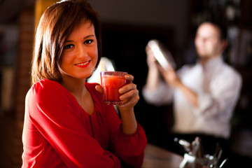 Woman holding a cocktail