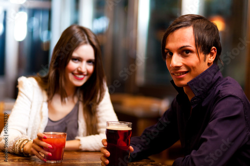 Friends having a drink in a pub