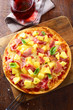 Delicious ham and pineapple pizza
