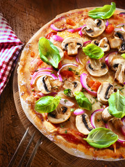 Tasty mushroom and onion pizza