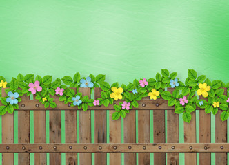 Wooden fence with a flower garland on the abstract background of