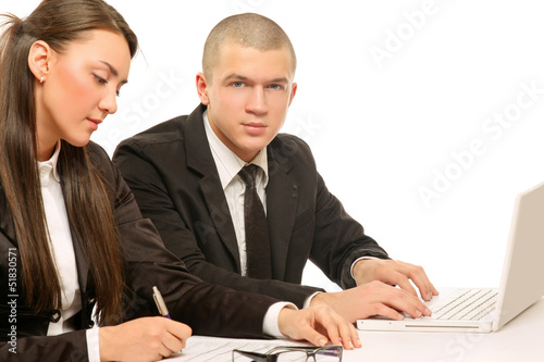 Businesspeople working at desk with a laptop, isolated on white