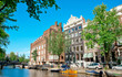 Amsterdam canals and typical houses with clear summer sky