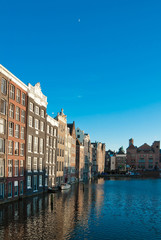 Amsterdam canals and typical houses with clear evening sky