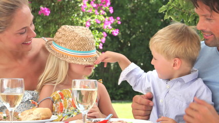 Family Enjoying Outdoor Meal Together