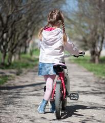 little girl on her bike