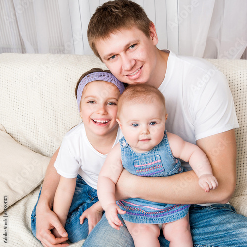 young father with two daughters