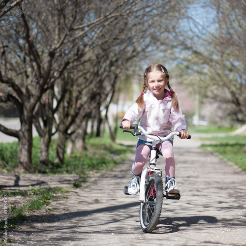 little girl on her bike