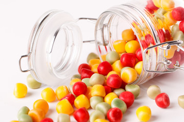 Colorful candies in glass jar.
