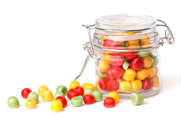 Colorful candies in glass jar. Isolated on white