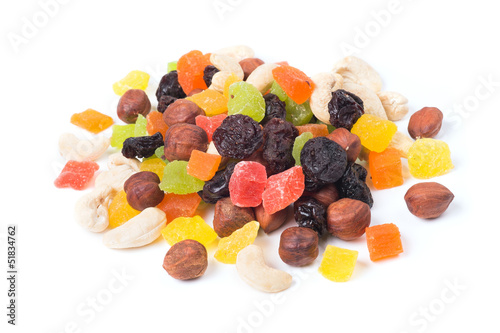 A mixture of dried fruits on a white background