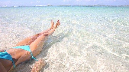 Young woman relaxing in transparent water