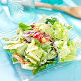 garden salad with fresh vegetables and ranch dressing
