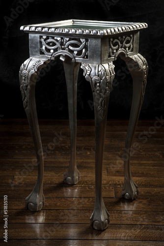 Vintage wooden table painted with silver color with carved legs