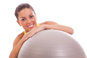 young woman holding fitness ball