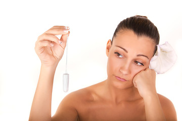 not again menstruation,woman holding vaginal tampon