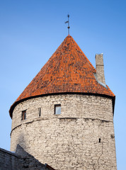Ancient stone tower with red tiled roof