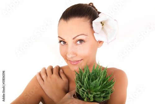 close up, woman's face with aloe