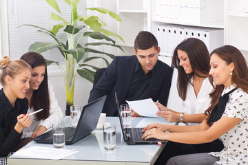 young modern business colleagues in office
