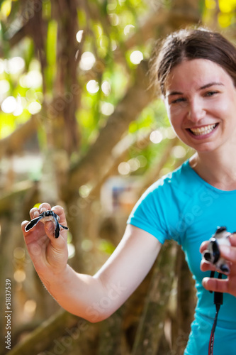 Newly hatched baby turtle in girls hand at Sea Turtles Conservat