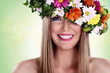 Smiling woman with flower wreath