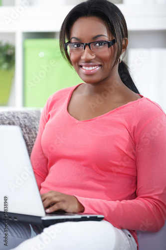 Cheerful student with laptop