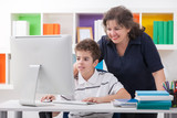 woman using computer with son