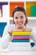 cheerful schoolgirl with books