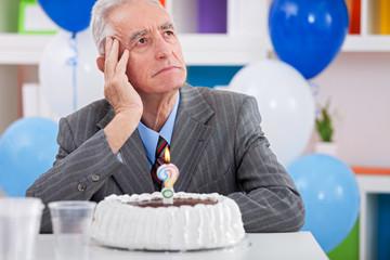 man having  Alzheimer's disease on birthday