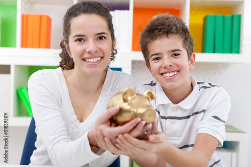 Children with piggybank