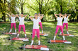 Group of women doing  warm up exercises