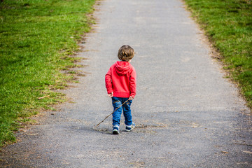 2 year old boy with red sweater playing