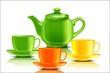 Зеленый чайник с разноцветными чашками