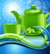 Зеленый чайник с чашкой среди волн