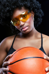 Fancy African woman with basketball