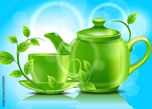 Зеленый чайник с чашкой