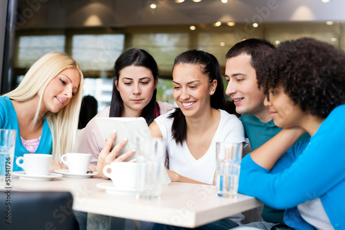 Group of young people in modern cafe
