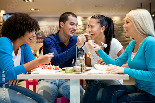 Group of teenagers enjoying in lunch