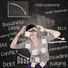 Businesswoman has headache and problems