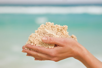 hands with white sand