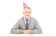 Happy mature gentleman with party hat
