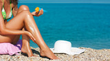 Tan Woman Applying Sunscreen on Legs - Fine Art prints