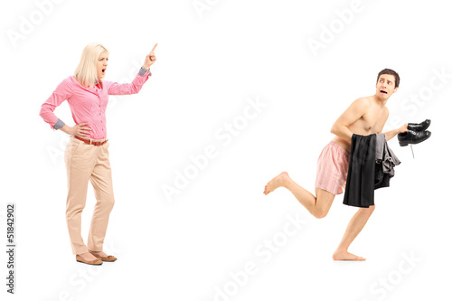 Full length portrait of a woman shouting at a naked guy running