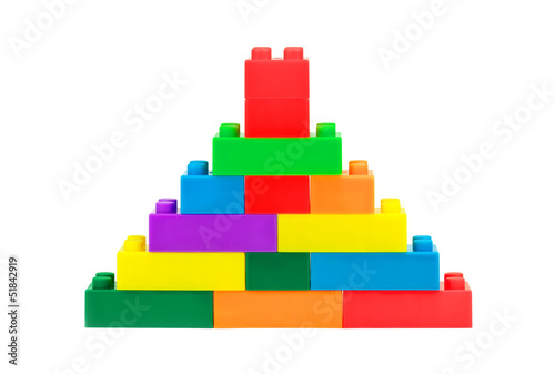 Tower made from colorful plastic toy blocks on white background