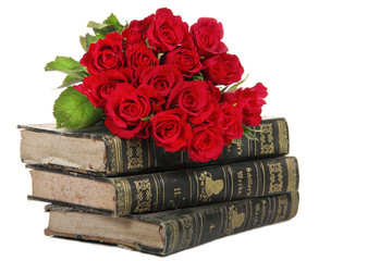 Rosen auf Bücherstapel - old books with roses