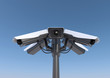 3d render of 6 security cameras on a pole.