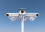 3d render of 6 security cameras on a pole close up.